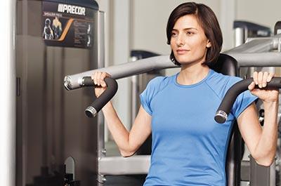 woman using repaired precor fitness machine